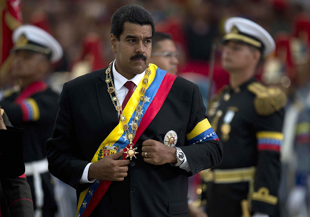 . Venezuelan President Nicolas Maduro receives military honours after his installation in Caracas on April 19, 2013.  LUIS ACOSTA/AFP/Getty Images