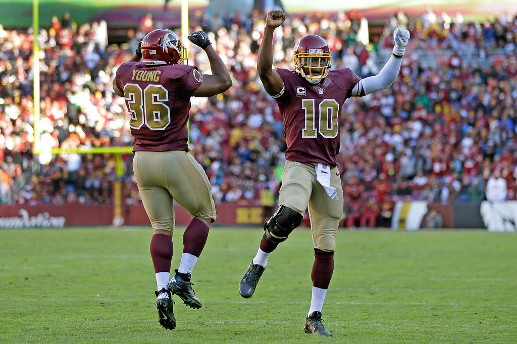 . Washington Redskins fullback Darrel Young celebrates his touchdown with quarterback Robert Griffin III, right, during the second half of a NFL football game against San Diego Chargers in Landover, Md., Sunday, Nov. 3, 2013. (AP Photo/Patrick Semansky)