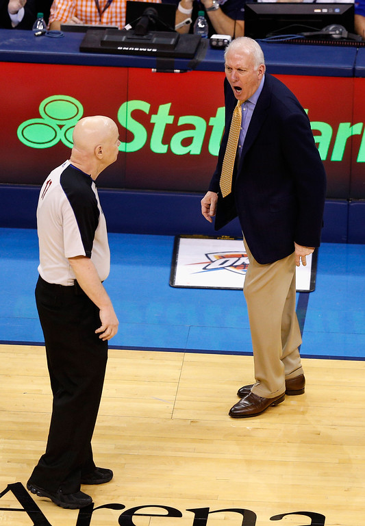 . OKLAHOMA CITY, OK - MAY 27: Head coach Gregg Popovich of the San Antonio Spurs reacts to a call by referee Joe Crawford #17 in the first half against the Oklahoma City Thunder during Game Four of the Western Conference Finals of the 2014 NBA Playoffs at Chesapeake Energy Arena on May 27, 2014 in Oklahoma City, Oklahoma. (Photo by Joe Robbins/Getty Images)