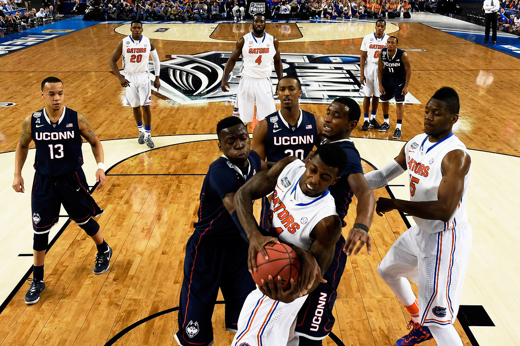 . ARLINGTON, TX - APRIL 05: Casey Prather #24 of the Florida Gators and Amida Brimah #35 of the Connecticut Huskies battle for a rebound during the NCAA Men\'s Final Four Semifinal at AT&T Stadium on April 5, 2014 in Arlington, Texas. (Photo by Chris Steppig-Pool/Getty Images)