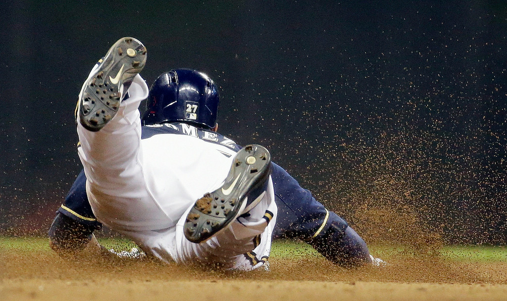 . Milwaukee Brewers\' Carlos Gomez steals second during the seventh inning of a baseball game against the Colorado Rockies on Thursday, June 26, 2014, in Milwaukee. (AP Photo/Morry Gash)