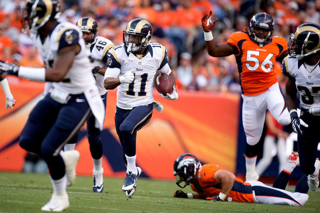 . DENVER, CO - AUGUST 24: Tavon Austin (11) of the St. Louis Rams breaks into the open field on a punt return to the Broncos\' one-yard line during the first half of action of an NFL preseason game at Sports Authority Field at Mile High on August 24, 2013. This is the third game of the preseason for the Broncos. (Photo by AAron Ontiveroz/The Denver Post)