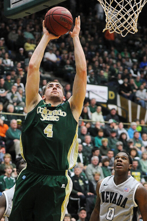 . Colorado State University senior Pierce Hornung (4) goes up for a shot between Nevada\'s Cole Huff, back left, and Marqueze Coleman in the second half of their game on Saturday, March 9, 2013 at Moby Arena. Steve Stoner, Loveland Reporter-Herald