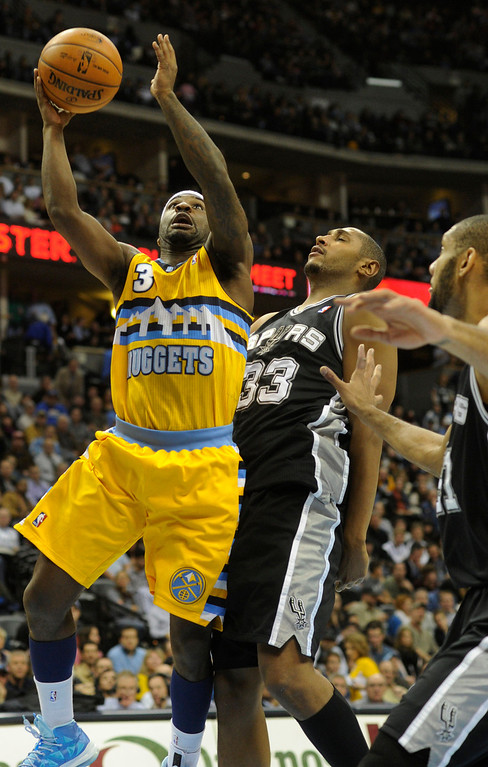 . Denver guard Ty Lawson (3) worked around Spurs defender Boris Diaw (33) in the second half. The Denver Nuggets defeated the San Antonio Spurs 112-106 at the Pepsi Center Tuesday night, December 18, 2012. Karl Gehring/The Denver Post