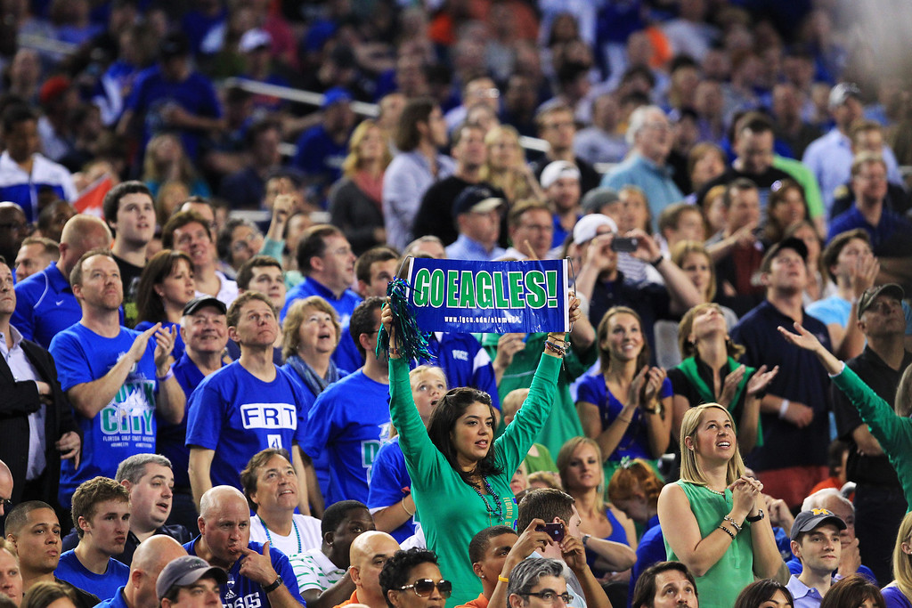 . ARLINGTON, TX - MARCH 29:  Florida Gulf Coast Eagles fans hold up signs in the first half against the Florida Gators during the South Regional Semifinal round of the 2013 NCAA Men\'s Basketball Tournament at Dallas Cowboys Stadium on March 29, 2013 in Arlington, Texas.  (Photo by Ronald Martinez/Getty Images)