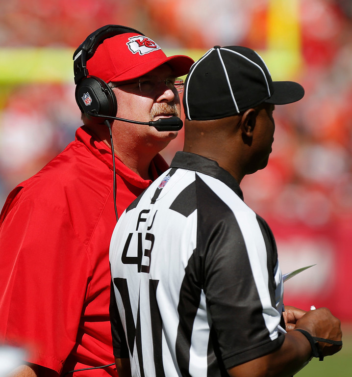 . Kansas City Chiefs coach Andy Reid, left, watches a replay next to field judge Terry Brown (43) during the first half of an NFL football game against the New York Giants at Arrowhead Stadium in Kansas City, Mo., Sunday, Sept. 29, 2013. (AP Photo/Ed Zurga)