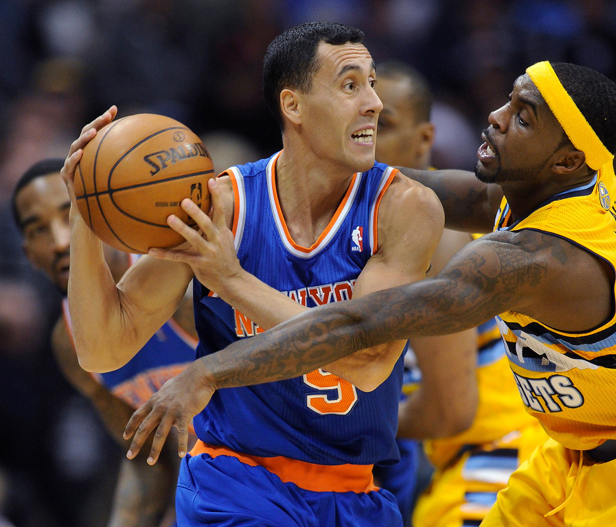 . Denver guard Ty Lawson, right, pressured New York\'s Pablo Prigioni in the second half.   Photo By Karl Gehring/The Denver Post