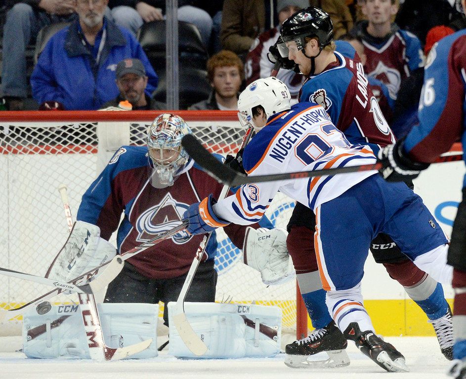 . DENVER, CO. - DECEMBER 19: Edmonton center Ryan Nugent-Hopkins (93) applied pressure to Colorado goaltender Semyon Varlamov (1) in the first period. The Colorado Avalanche hosted the Edmonton Oilers in an NHL game at the Pepsi Center Thursday night, December 19, 2013.  Photo By Karl Gehring/The Denver Post