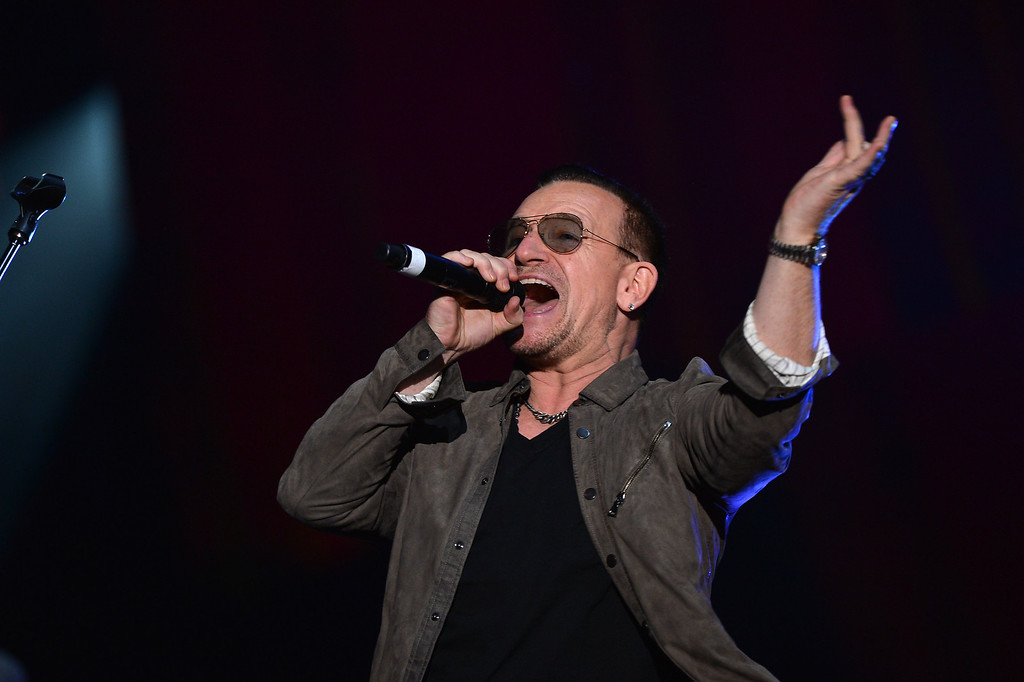. NEW YORK, NY - SEPTEMBER 28:  Bono appears on stage at the 2013 Global Citizen Festival in Central Park to end extreme poverty on September 28, 2013 in New York City, New York.  (Photo by Stephen Lovekin/Getty Images for Global Citizen Festival)