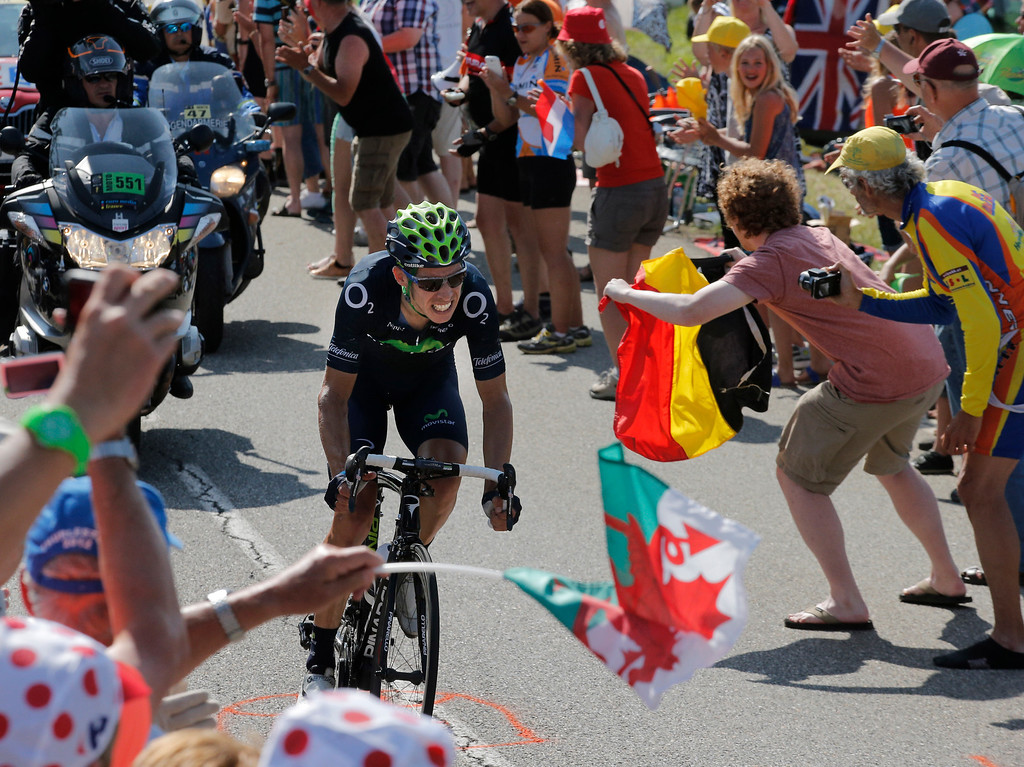 . Stage winner Rui Alberto Costa of Portugal climbs Manse pass during the sixteenth stage of the Tour de France cycling race over 168 kilometers (105 miles) with start in in Vaison-la-Romaine and finish in Gap, France, Tuesday July 16, 2013. (AP Photo/Christophe Ena)