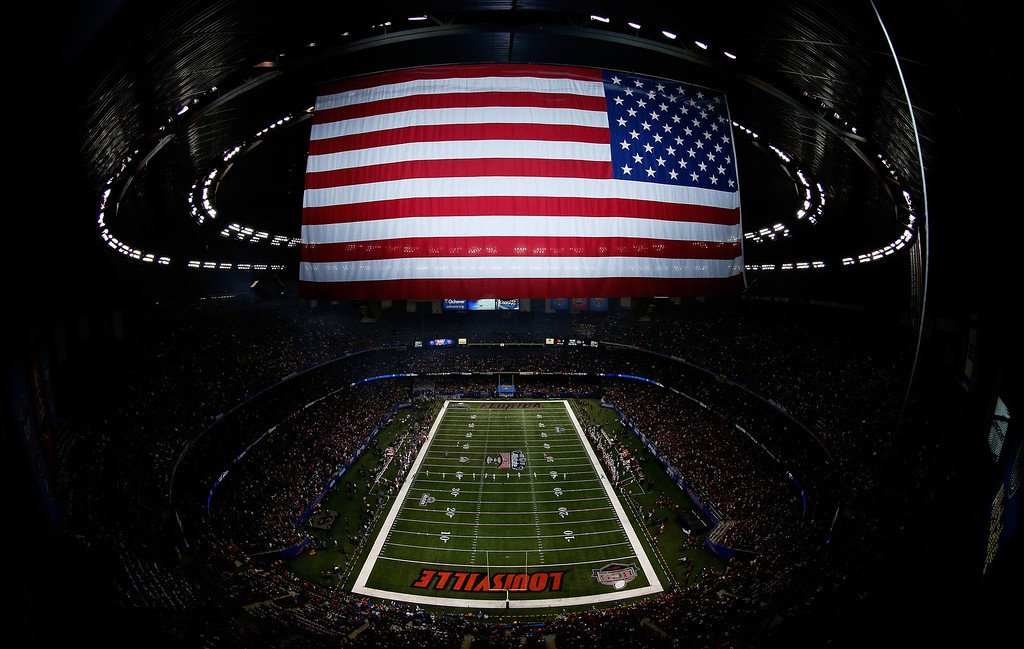 . A general view as John Wallace #45 of the Louisville Cardinals kicks off to start the game against the Florida Gators at the Allstate Sugar Bowl at Mercedes-Benz Superdome on January 2, 2013 in New Orleans, Louisiana.  (Photo by Chris Graythen/Getty Images)