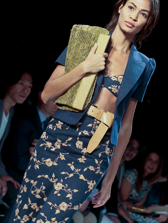 . Fashion from the Spring 2014 collection of Michael Kors is modeled on Wednesday, Sept. 11, 2013 in New York.  (AP Photo/Bebeto Matthews)