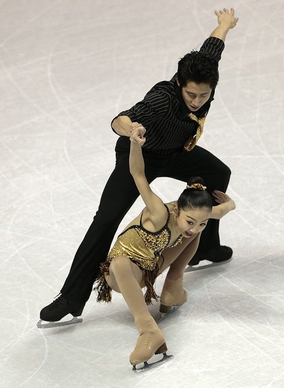 . Wenjing Sui and Cong Han compete for China during the Pairs Free Skating event at the 2013 World Figure Skating Championships March 15, 2013 in London, Ontario, Canada.    AFP PHOTO/Geoff  ROBINS/AFP/Getty Images