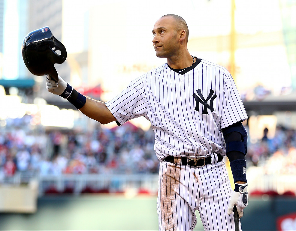 . American League All-Star Derek Jeter #2 of the New York Yankees acknowledges the crowd before his first at bat during the 85th MLB All-Star Game at Target Field on July 15, 2014 in Minneapolis, Minnesota.  (Photo by Elsa/Getty Images)