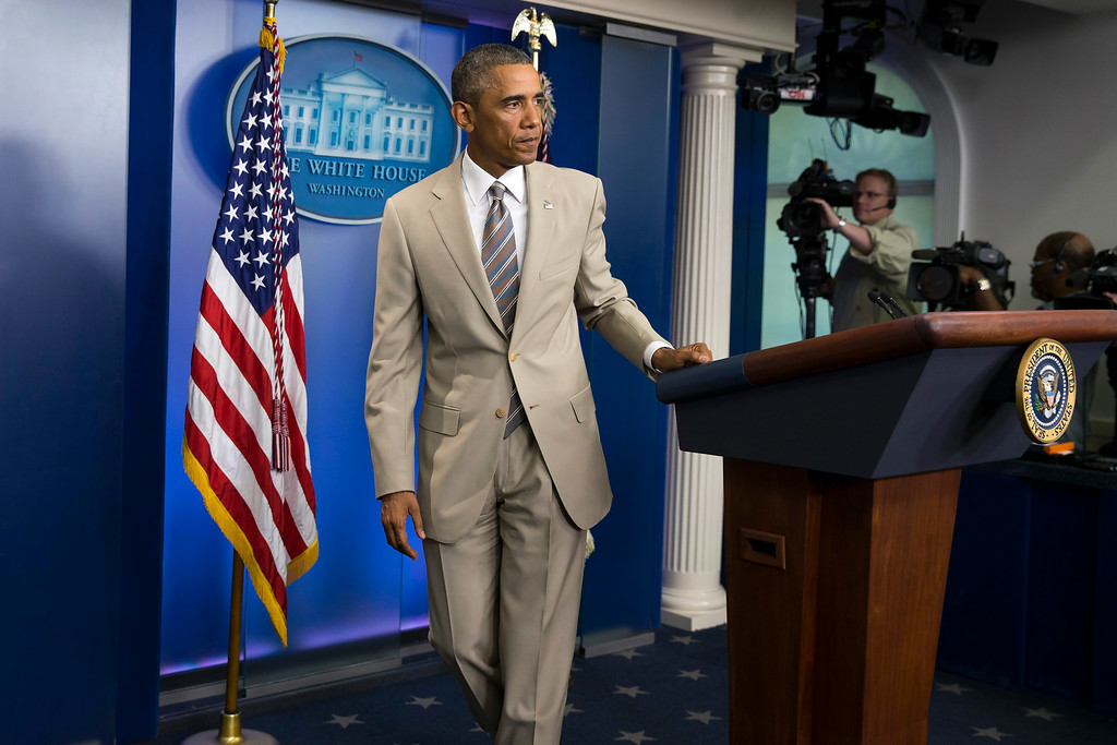 . In this Thursday, Aug. 28, 2014 file photo, President Barack Obama leaves after speaking about the economy, Iraq, and Ukraine, in the James Brady Press Briefing Room of the White House in Washington, before convening a meeting with his national security team on the militant threat in Syria and Iraq.  Obama\'s summer fashion choice, not unprecedented among presidents - himself included - was the talk of social media, Thursday. Other presidents who have taken on tan include Bill Clinton, Ronald Reagan, George H. W. Bush, George W. Bush and Dwight Eisenhower. (AP Photo/Evan Vucci, file)