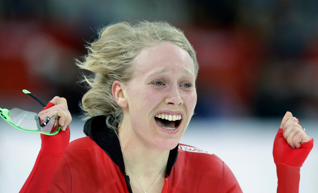 . Norway\'s Mari Hemmer celebrates her performance in the women\'s 5,000-meter speedskating race at the Adler Arena Skating Center during the 2014 Winter Olympics in Sochi, Russia, Wednesday, Feb. 19, 2014. (AP Photo/Matt Dunham)