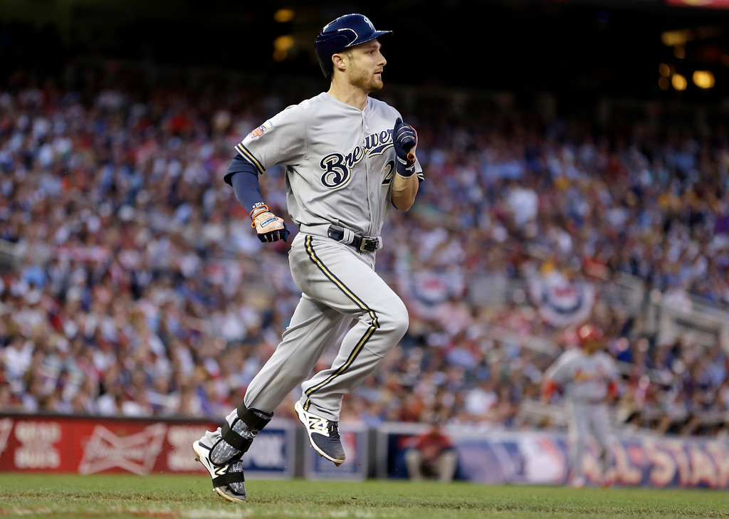 . National League catcher Jonathan Lucroy, of the Milwaukee Brewers, hits an RBI double during the fourth inning of the MLB All-Star baseball game, Tuesday, July 15, 2014, in Minneapolis. (AP Photo/Jeff Roberson)