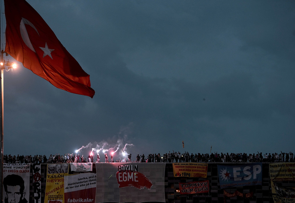 . Protesters stand at the roof of a builing at sunset in Taksim square in Istanbul on June 4, 2013.  AFP PHOTO / ARIS  MESSINIS/AFP/Getty Images