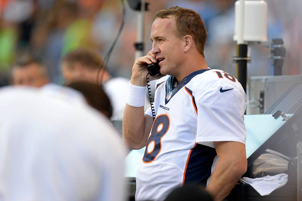 . SEATTLE, WA. - AUGUST 17: Denver Broncos quarterback Peyton Manning (18) on the phone to the coaches during the first quarter against the Seattle Seahawks August 17, 2013 at Century Link Field. (Photo By John Leyba/The Denver Post)