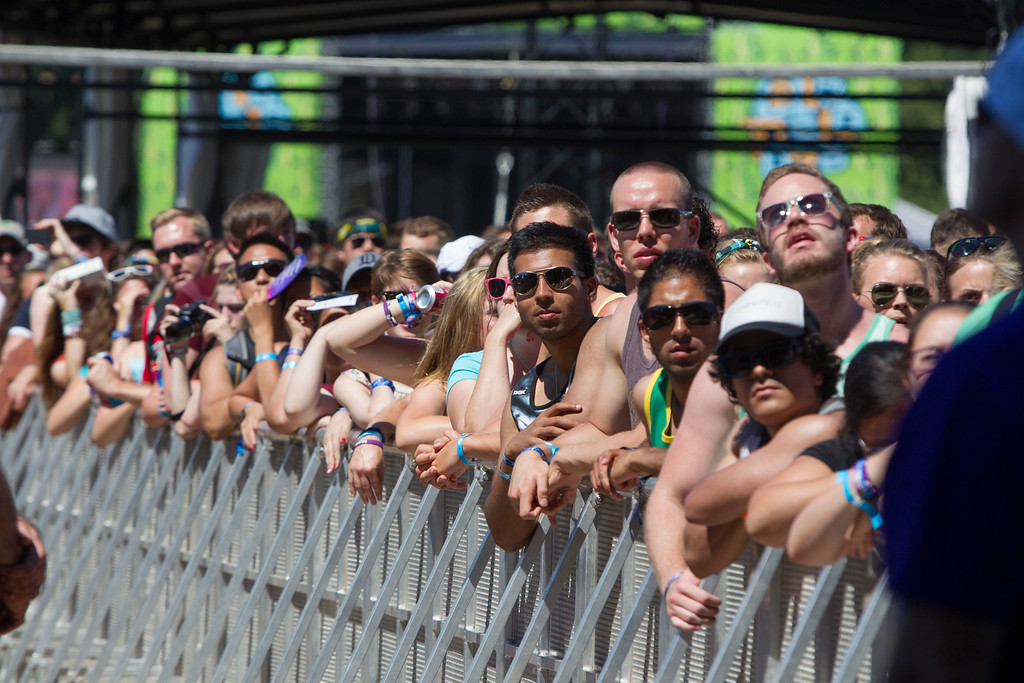 . Festival attendees wait for the next act to take the Red Bull Stage at the Lollapalooza Festival in Chicago, Saturday, Aug. 3, 2013. The more than two-decade-old festival opened Friday in Chicago\'s lakefront Grant Park. (AP Photo/Scott Eisen)