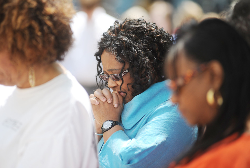 . Pearl Owens listens to prayers as the National Day of Prayer is celebrated in Oxford, Miss. on Thursday, May 1, 2014.  (AP Photo/Oxford Eagle, Bruce Newman)