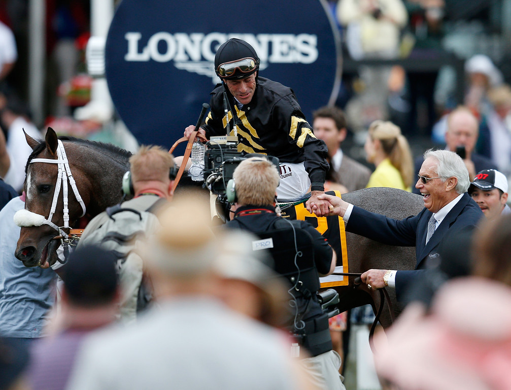 . BALTIMORE, MD - MAY 18:  Trainer D. Wayne Lucas congratulates Gary Stevens on the way to Winner\'s Circle after their horse, Oxbow #6 won the 138th running of the Preakness Stakes at Pimlico Race Course on May 18, 2013 in Baltimore, Maryland.  (Photo by Rob Carr/Getty Images)