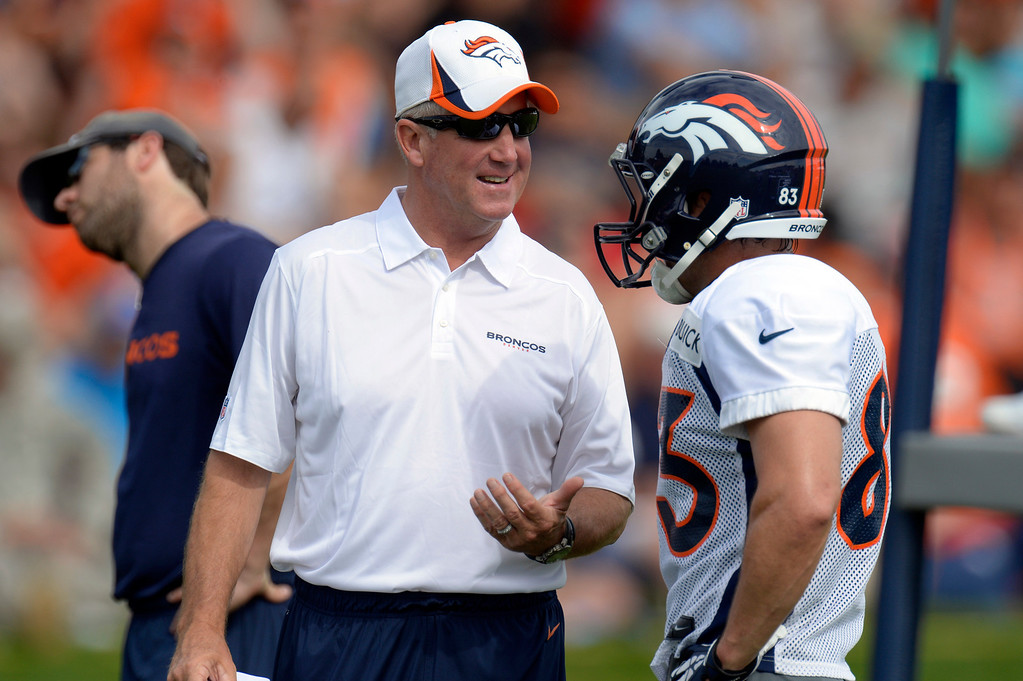 . Denver Broncos head coach John Fox talks with WR Wes Welker during training camp August 1, 2013 at Dove Valley. (Photo By John Leyba/The Denver Post)