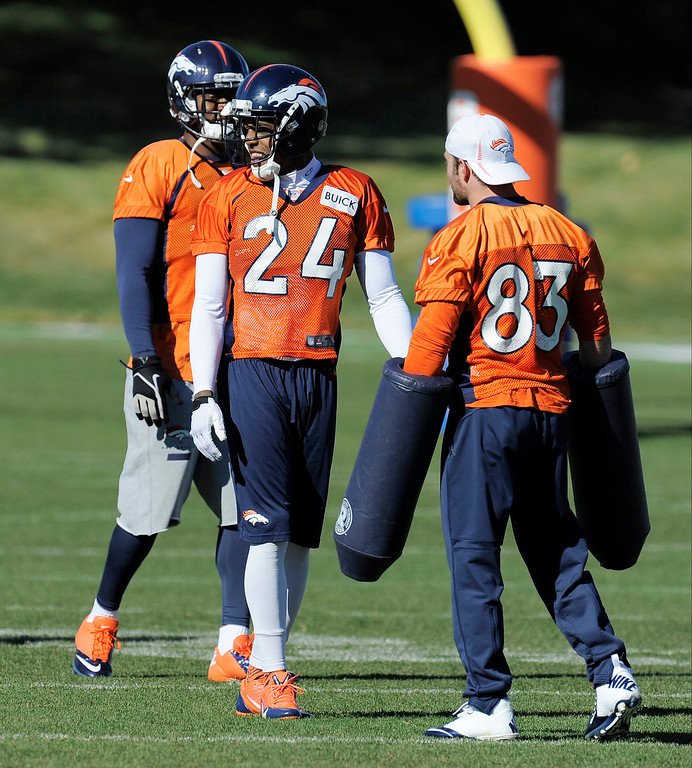 . ENGLEWOOD, CO - OCTOBER 27: Denver Broncos Wes Welker (83) helps out with drills during practice on October 30, 2013 at Dove Valley. (Photo by John Leyba/The Denver Post)
