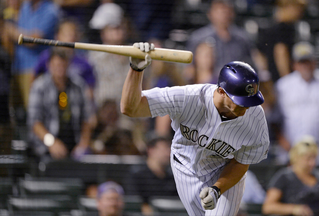 . Colorado Rockies DJ LeMahieu (9) slams his bat down after he was called out on strikes for the last out in the 9th as the Arizona Diamondbacks defeat the Rockies 4-2 June 3, 2014 at Coors Field. LeMahieu argued the call with Jerry Layne. (Photo by John Leyba/The Denver Post)