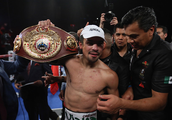 PHOTOS: Boxer Mike Alvarado vs. Juan Manuel Marquez