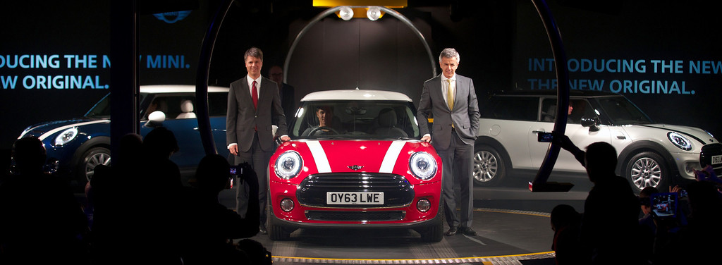 . Members of the board of management at BMW Harald Krueger (L) and Peter Schwarzenbauer stand next to the new Mini Cooper during its official unveiling at BMW\'s plant at Cowley in Oxford, central England, on November 18, 2013. Car giant BMW, which has been manufacturing the Mini since 2001, has finally taken the wraps off the  new Mini that will be available in the UK in Spring 2014. ANDREW COWIE/AFP/Getty Images