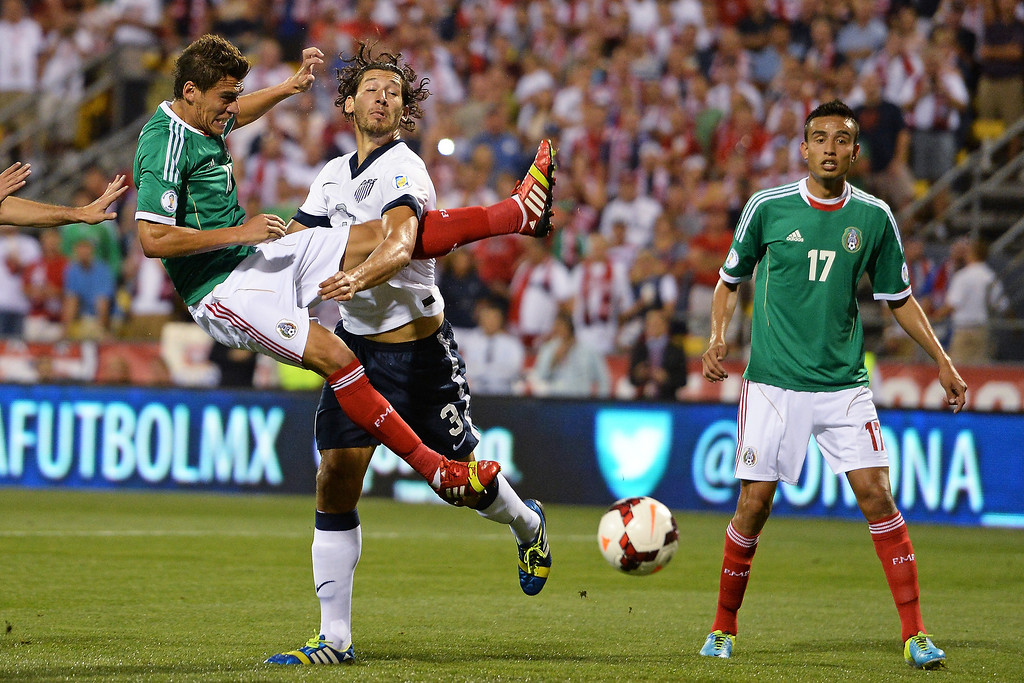 . Omar Gonzalez #3 of the United States Men\'s National Team defends against Hector Moreno #15 of the Mexico Men\'s National Team during a first half corner kick at Columbus Crew Stadium on September 10, 2013 in Columbus, Ohio.  (Photo by Jamie Sabau/Getty Images)