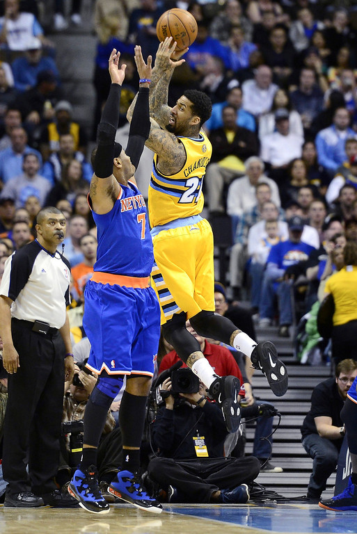 . Denver Nuggets player Wilson Chandler is defended by the New York Knicks\' Carmelo Anthony during the first half of action. The Denver Nuggets take on the New York Knicks. (Photo by AAron Ontiveroz/The Denver Post)