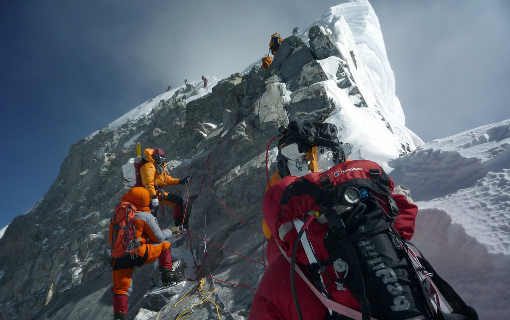 . (FILES) In this photograph taken on May 19, 2009, unidentified mountaineers approach the Hillary Step while pushing for the summit of Mount Everest as they climb the south face from Nepal. At least 12 Nepalese guides preparing routes up Mount Everest for commercial climbers were killed by an avalanche in the most deadly mountaineering accident ever on the world\'s highest peak, officials and rescuers say. The men were among a large party of Sherpas carrying tents, food and ropes who headed out in bright sunshine in an early morning expedition ahead of the main climbing season starting later this month. The previous worst accident occurred in 1996 when eight people were killed over a two-day period during a rogue storm while attempting to climb the mountain.  AFP PHOTO / PEMBA DORJE SHERPA