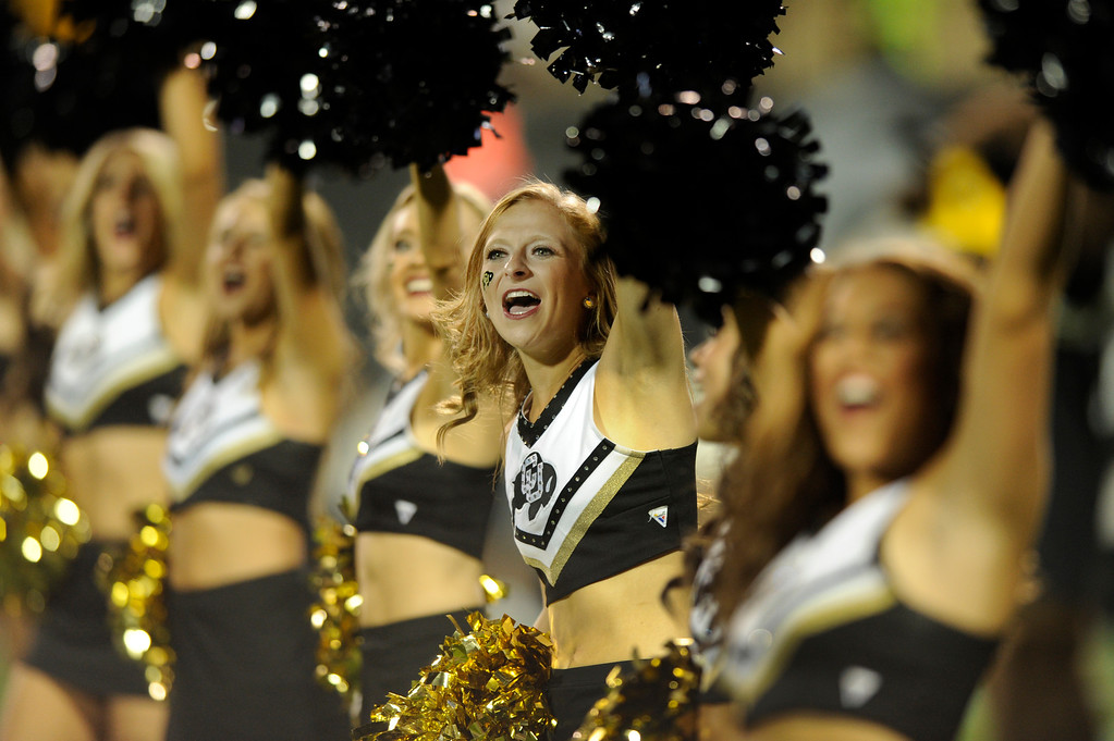 . BOULDER, CO. - SEPTEMBER 76: CU cheerleaders performed on the field at the beginning of the fourth quarter. The University of Colorado football team hosted Central Arkansas at Folsom Field Saturday night, September 7, 2013. Photo By Karl Gehring/The Denver Post