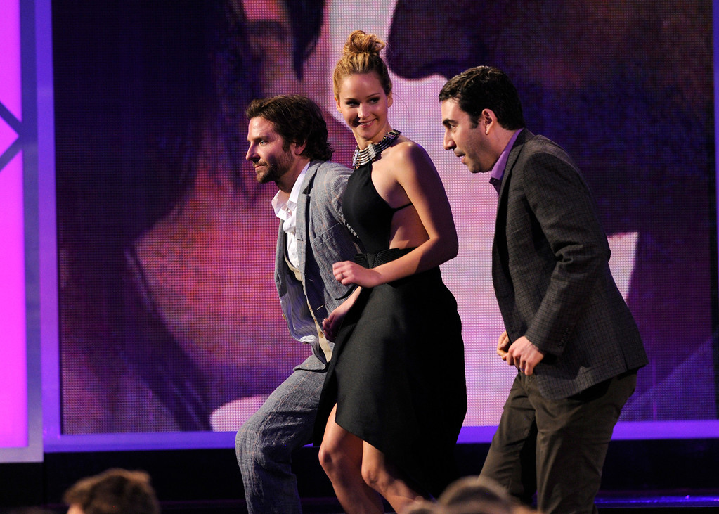 ". Actor Bradley Cooper, actress Jennifer Lawrence, and producer Jonathan Gordon accept the award for best feature for ""Silver Linings Playbook\"" at the Independent Spirit Awards on Saturday, Feb. 23, 2013, in Santa Monica, Calif. (Photo by Chris Pizzello/Invision/AP)"