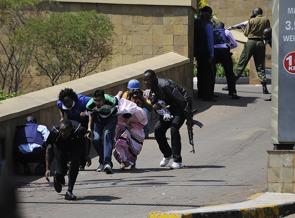. A policeman carry\'s a baby to safety after masked gunmen stormed an upmarket mall and sprayed gunfire on shoppers and staff, killing at least six on September 21, 2013 in Nairobi. AFP PHOTO/SIMON  MAINA/AFP/Getty Images