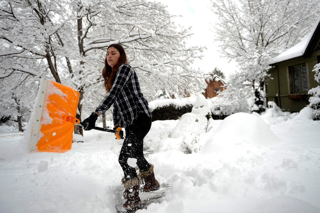 ". BOULDER, CO. - APRIL 23: Astronomy major Diana Shukis cleaning the sidewalk in front of the home she is house sitting after her early class. Originally from Las Vegas this is the first time she has ever shoveled snow. ""I don\'t think I\'m doing this very efficiently,\"" she said. April 23, 2013 Boulder, Colorado. (Photo By Joe Amon/The Denver Post)"