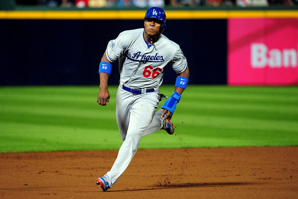 . ATLANTA, GA - OCTOBER 03: Yasiel Puig #66 of the Los Angeles Dodgers runs to third base against the Atlanta Braves during Game One of the National League Division Series at Turner Field on October 3, 2013 in Atlanta, Georgia.  (Photo by Scott Cunningham/Getty Images)