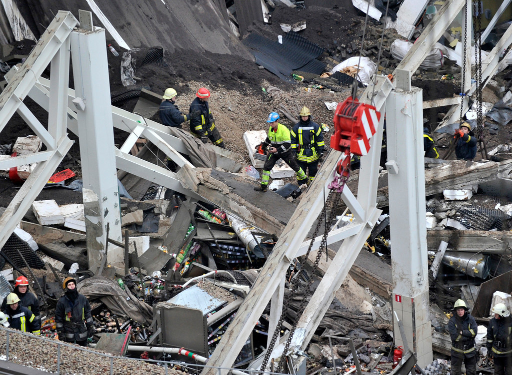 . Rescue workers search debris of the Maxima supermarket in Riga, Latvia, Friday, Nov. 22, 2013.  (AP Photo/ Roman Koksarov)