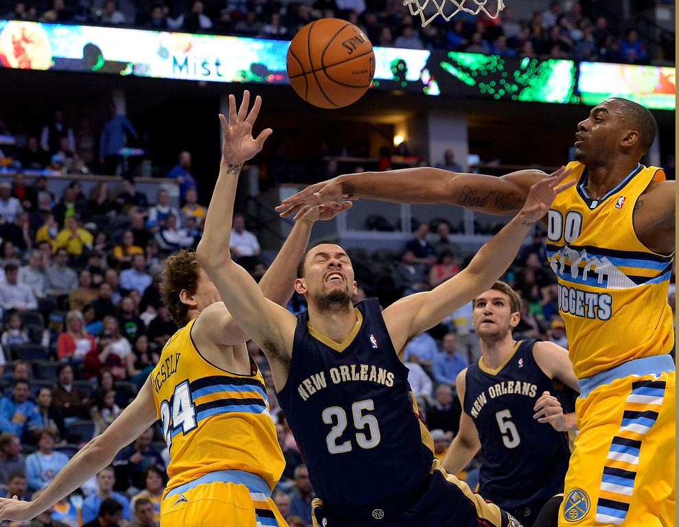 . New Orleans Pelicans guard Austin Rivers (25) loose control of the ball as Denver Nuggets forward Jan Vesely (24) and ,d00 defend on the play April 2, 2014 at the Pepsi Center in Denver. (Photo by John Leyba/The Denver Post)