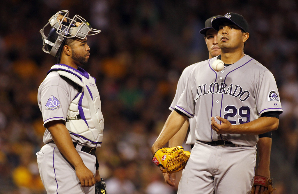 . PITTSBURGH, PA - AUGUST 03:  Jorge De La Rosa #29 of the Colorado Rockies reacts in the fifth inning before being relieved against the Pittsburgh Pirates during the game on August 3, 2013 at PNC Park in Pittsburgh, Pennsylvania.  (Photo by Justin K. Aller/Getty Images)