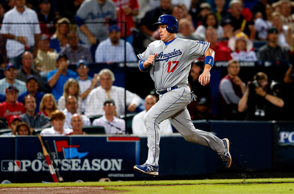 . ATLANTA, GA - OCTOBER 03: A.J. Ellis #17 of the Los Angeles Dodgers scores in the fourth inning against the Atlanta Braves during Game One of the National League Division Series at Turner Field on October 3, 2013 in Atlanta, Georgia.  (Photo by Kevin C. Cox/Getty Images)