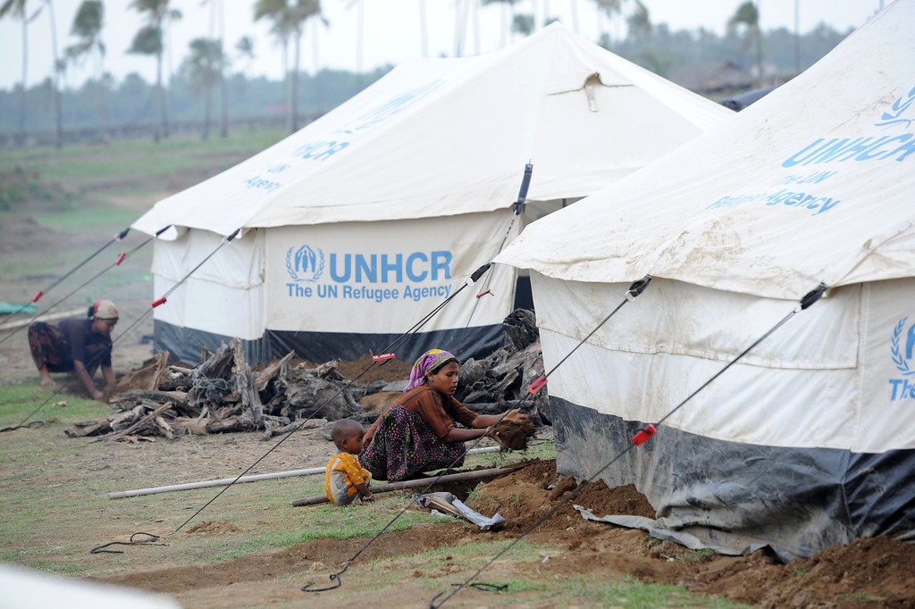 . Rohingya women reinforce their tents at the Ohnedaw Internally Displaced Persons (IDP) camp on the outskirts of Sittwe on May 15, 2013, as Cyclone Mahasen heads towards landfall. Hundreds of thousands of people in Bangladesh and Myanmar were ordered to evacuate Wednesday as a cyclone bore down on coastal areas home to flood-prone refugee camps for victims of sectarian unrest. Soe Than WIN/AFP/Getty Images