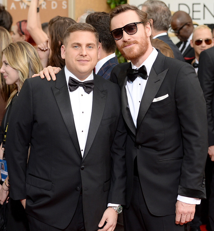 . Actors Jonah Hill (L) and Michael Fassbender attend the 71st Annual Golden Globe Awards held at The Beverly Hilton Hotel on January 12, 2014 in Beverly Hills, California.  (Photo by Jason Merritt/Getty Images)