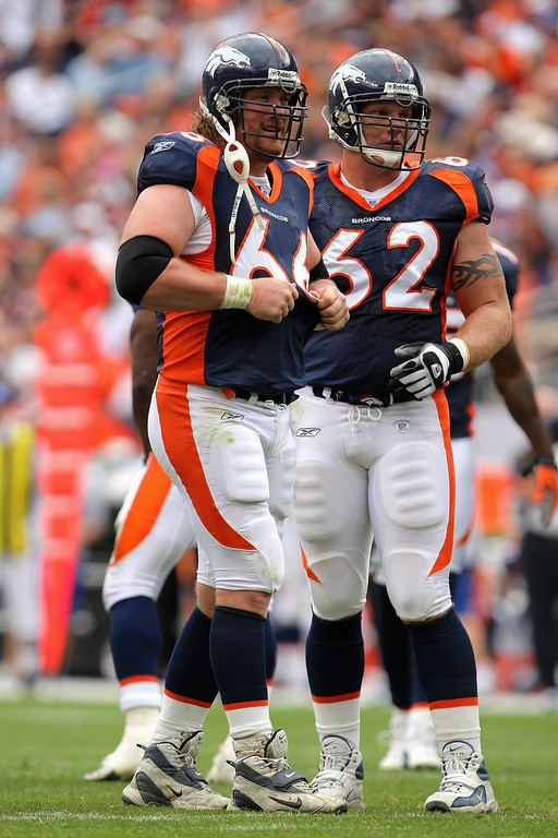 . Tom Nalen #66 and Chris Myers #62 of the Denver Broncos stand on the field against the Jacksonville Jaguars at Invesco Field at Mile High on September 23, 2007 in Denver, Colorado. The Jaguars won 23-14. (Photo by Doug Pensinger/Getty Images)