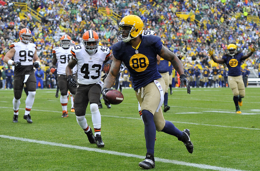 . Jermichael Finley #88 of the Green Bay Packers scores on a 10-yard touchdown reception during the first quarter against the Cleveland Browns at Lambeau Field on October 20, 2013 in Green Bay, Wisconsin.  (Photo by Brian Kersey/Getty Images)