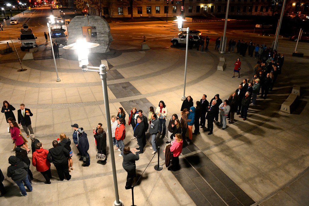 ". Couples, friends and family members wait to enter the Wellington E. Webb Municipal Office Building in Denver on April 30, 2013. The Clerk and Recorder\'s Office opened for business from midnight to 3 a.m. to issue civil union licenses to couples on May 1, 2013, when the Civil Union Act became law. The excitement was palpable among the friends and family who gathered to witness. ""It\'s a proud night for my family,\"" said Juan Moreno, who came to support his daughter, Hillary. \""It\'s not right it took so long, because people shouldn\'t judge. Love is a hard enough thing to find.\"""