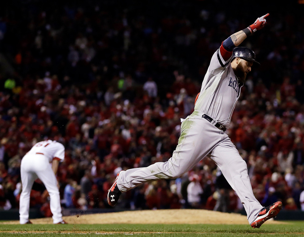 . Boston Red Sox\'s Jonny Gomes celebrates his three-run home run off St. Louis Cardinals relief pitcher Seth Maness, left, during the sixth inning of Game 4 of baseball\'s World Series Sunday, Oct. 27, 2013, in St. Louis. (AP Photo/Jeff Roberson)