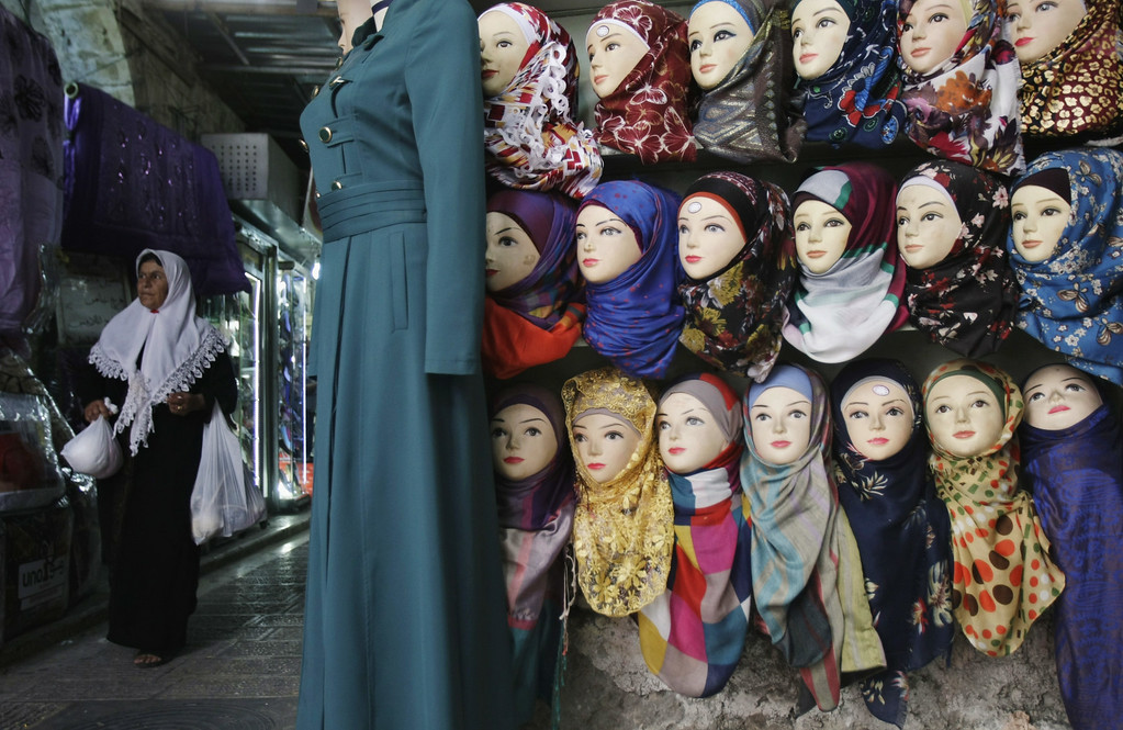. A Palestinian vendor displays headscarfs on mannequins for sale at a shop ahead of Ramadan in the West Bank city of Nablus on Saturday, June 28, 2014. Muslims throughout the world are preparing themselves before the holy month of Ramadan, where observants fast from dawn till dusk.(AP Photo/Nasser Ishtayeh)